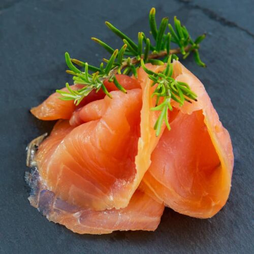 slices of artisan smoked salmon on slate